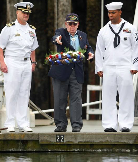 Navy Personnel and a Veteran Offering a Wreath